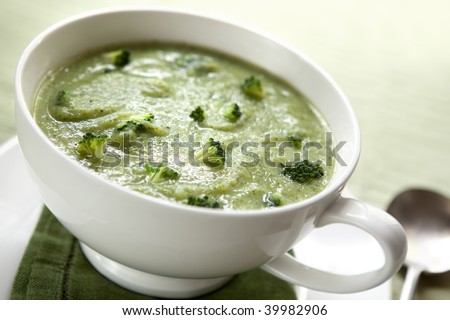 Cream of broccoli soup, in a soup mug.  Healthy eating.