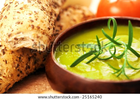 cream of broccoli soup. vevetable soup with rosemary as garnish