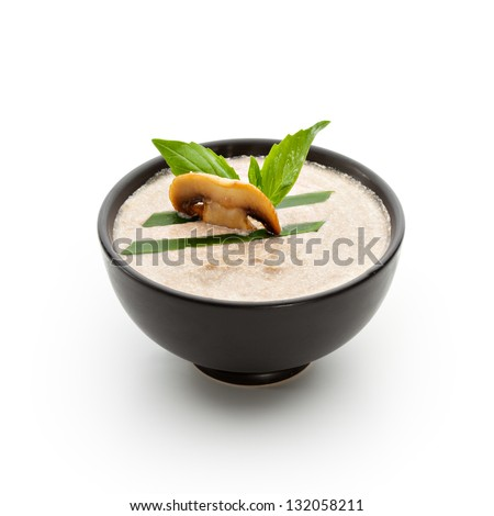 Cream of Mushroom Soup with Lettuce and Basil Leaf