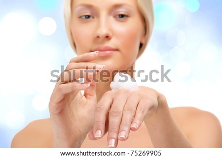 Cream on the women hand.