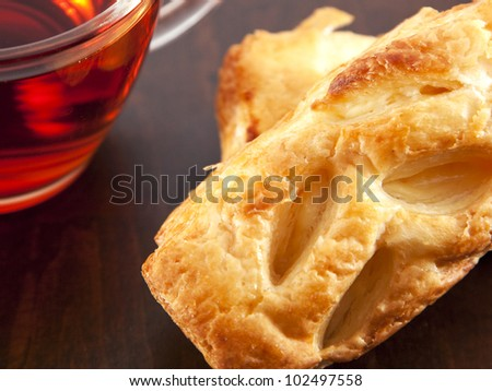 Cream puffs pastry with cup of tea