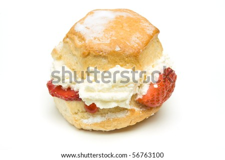 Cream Scone with strawberry from low perspective isolated against whitebackground.