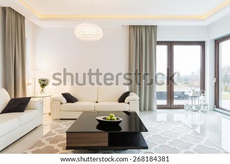 Cream sofa in luxury designed sitting room #268184381