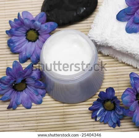 Cream, stones and towel with flowers