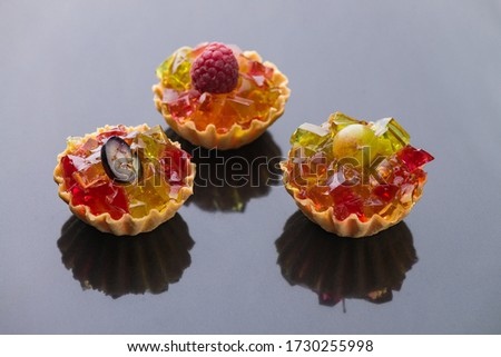 cream tartlets,  fruit tartlets, tartlets with strawberries, tartlets with salad,   with prosciutto.