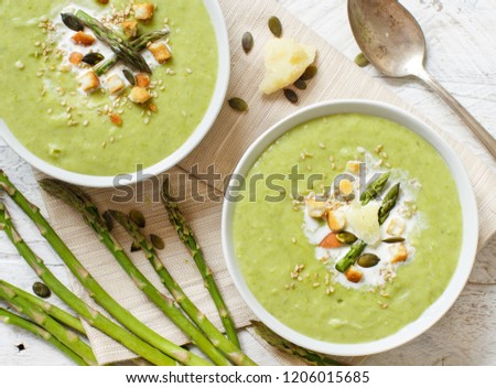 Creamy asparagus and potatoes soup puree on a wooden table Stock photo ©