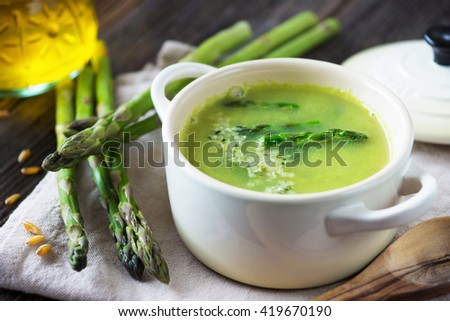 Creamy asparagus soup on wooden background Stock photo ©