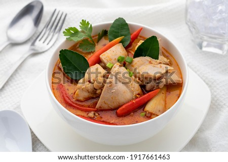Creamy chicken tom yum soup or tom yum gai in Thai. This authentic tomyum soup is also one of Thailand's signature dish popularly served in Thai restaurants throughout Thailand.  Foto stock ©