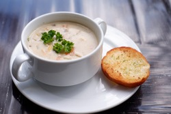 creamy clam chowder soup on table