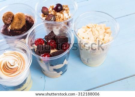 Creamy dessert in plastic cup