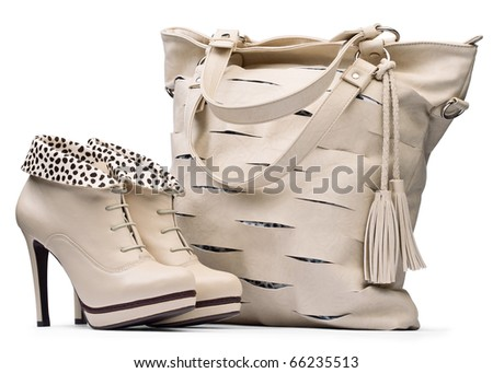 Creamy female high-heeled boots and leather bag isolated on white background. with path
