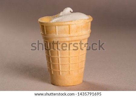 creamy ice cream in a waffle cup  #1435791695