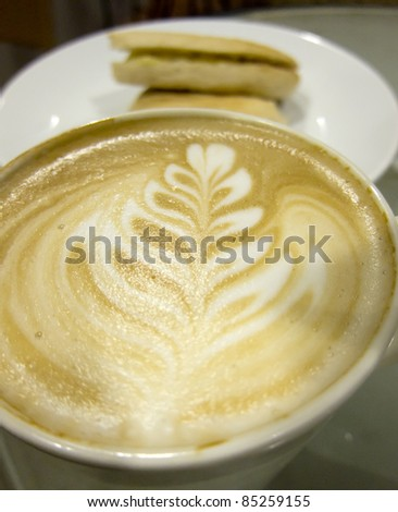 Creamy Latte Coffee With Pattern Plus Biscuits - stock photo
