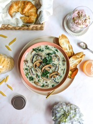 Creamy Mushroom and Spinach Soup Served with Toasted Baguette