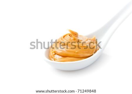 Creamy peanut butter in a white spoon