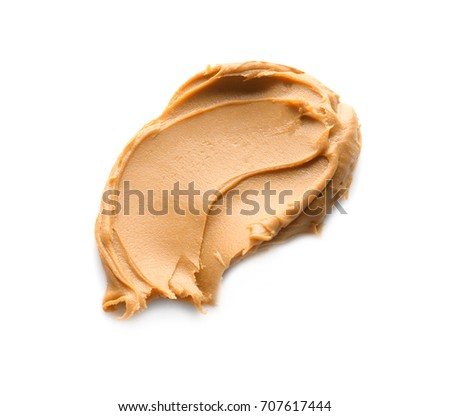 Creamy peanut butter on white background