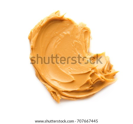 Creamy peanut butter on white background #707667445