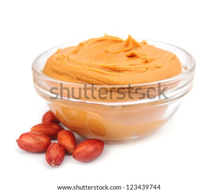 Creamy peanut butter with nuts isolated on white