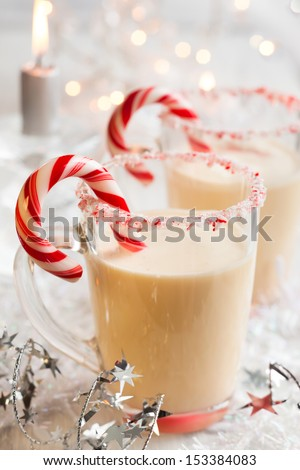 Creamy Peppermint Punch with candy cane