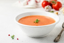 Creamy tomato soup. Selective focus, copy spce.