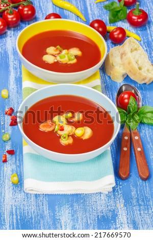 Creamy Tomato Soup. Two bowls of delicious tomato soup. Macro, selective focus.