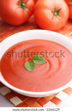 Creamy Tomato Soup With Basil Leaves As Garnish Stock ... Cream Of Tomato Soup With Garnish