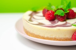 Creamy vanilla baked cheesecake, swirled with raspberry sauce on a biscuit crumb base, summer cake