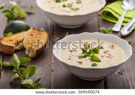 Creamy zucchini soup with chilli and oregano, crispy bread with garlic