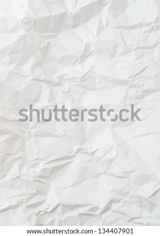 Creased and wrinkled crumpled white paper background - stock photo
