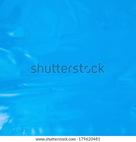 Creased plastic blue polyethylene film texture
