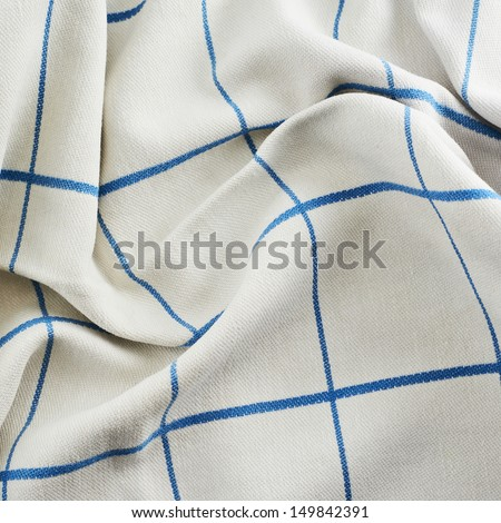 Creased tablecloth cloth fragment as abstract texture