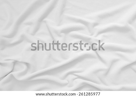 Creased white cloth material fragment as a background