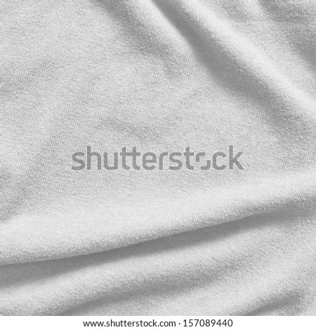 Creased white cloth material fragment as a background texture