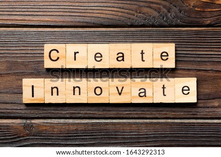 Create innovate word written on wood block. Create innovate text on wooden table for your desing, Top view concept.