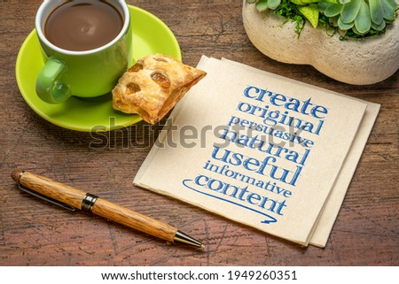 create original, persuasive, natural, useful, informative content - creating content advice - handwriting on napkin with cup of coffee Foto stock ©