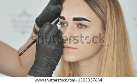 Create permanent eyebrow makeup. Eyebrow dyeing. Face close-up