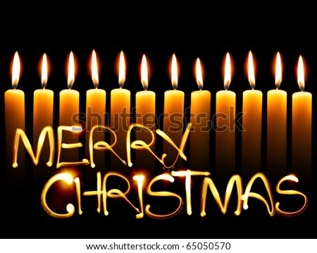 Created by light text Merry Christmas and candles