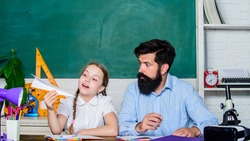 Creating a community of learners. Teacher and schoolgirl. Man bearded pedagogue and pupil having fun. Developing caring learners who are actively growing and achieving. School learners leisure.