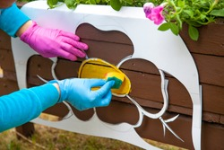Creating a decorative stencil. Drawing a stencil on the tree. Flowerbed in the park. Figure flower for decoration. How to decorate the garden. Paint use