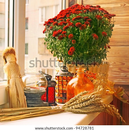 Creation of autumn  on a balcony by candlesticks