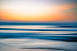 Creative abstract background. Sunset over the sea, line art, soft blur, pink and blue colors