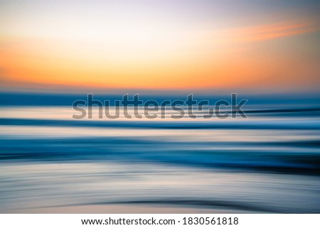 Creative abstract background. Sunset over the sea, line art, soft blur, pink and blue colors Foto stock ©