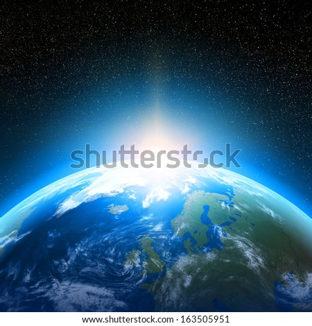 Creative abstract global communication scientific concept: space view of sunrise above Earth planet globe with world map in Solar System of Universe