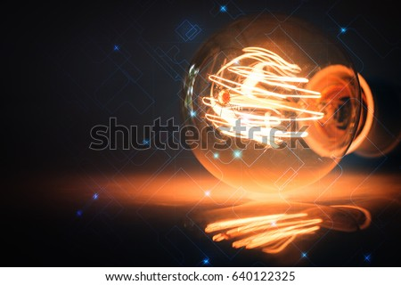 Creative abstract technology background with light bulb as concept