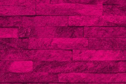 creative aged pink natural quartzite stone bricks texture for use as background.