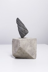 Creative arrangement, minimalistic home decor with sculpture made of river stone