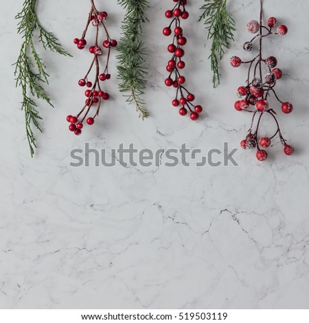 Creative arrangement of Christmas decoration on marble table. Holiday concept. Flat lay.