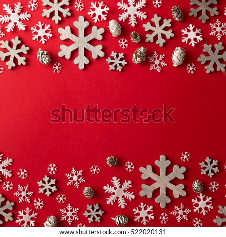 Creative arrangement of Christmas decoration on red background. Holiday concept. Flat lay.