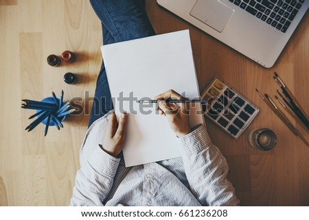 Creative artist working from home in a cozy atmosphere