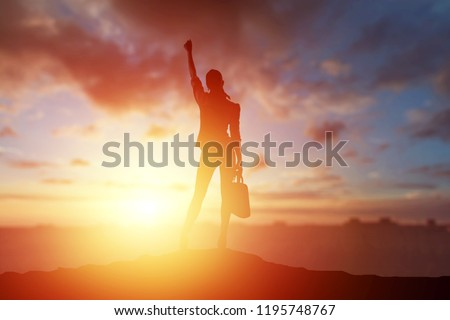 Creative background, business silhouette, business girl on the background of a beautiful, golden sunset. The concept of inspiration, enthusiasm, start-up, feminism symphony. Сток-фото ©